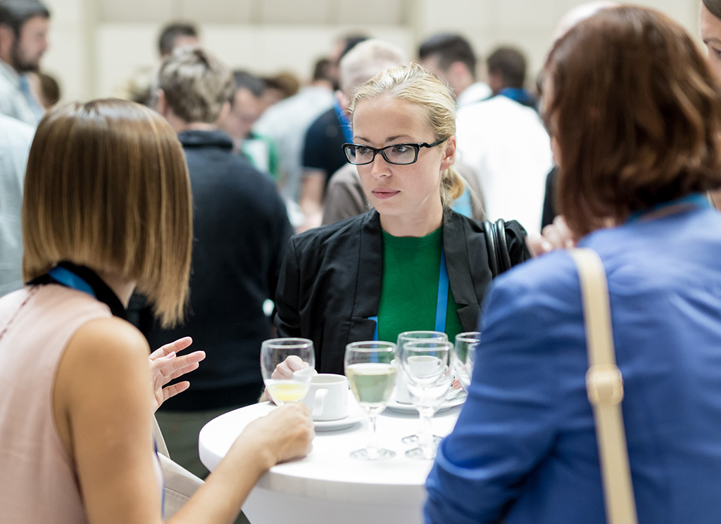 Delegates talking during a conference meal