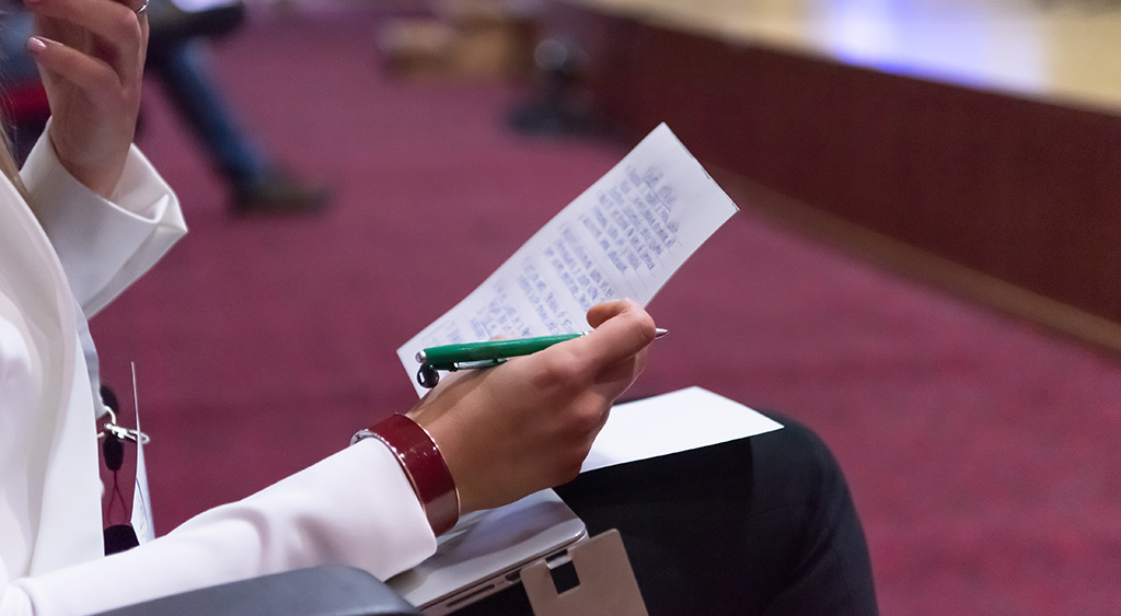 Taking notes for a blog post at a conference