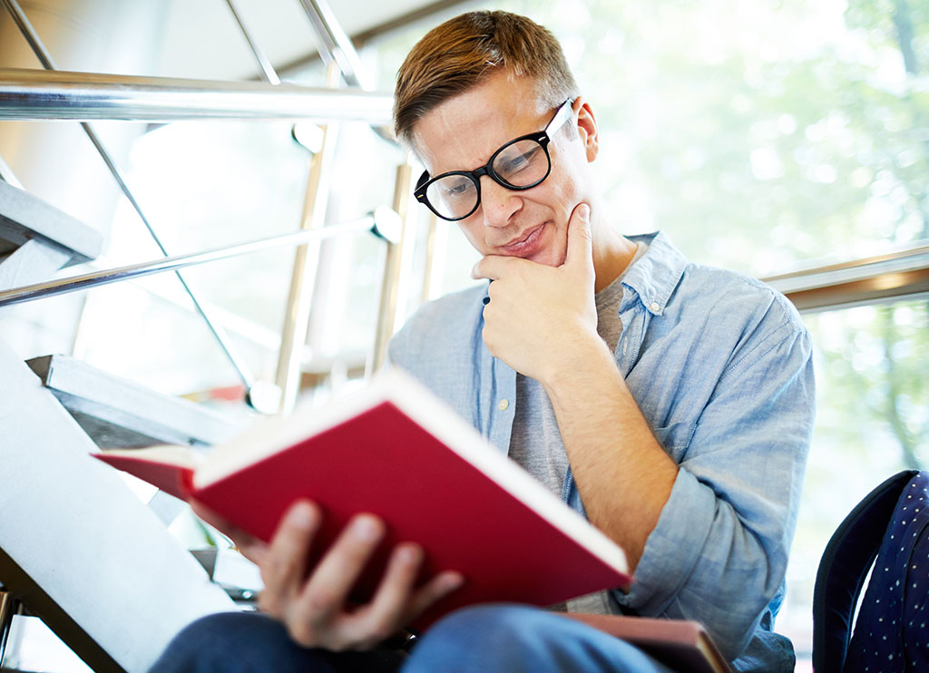 Confused person reading book