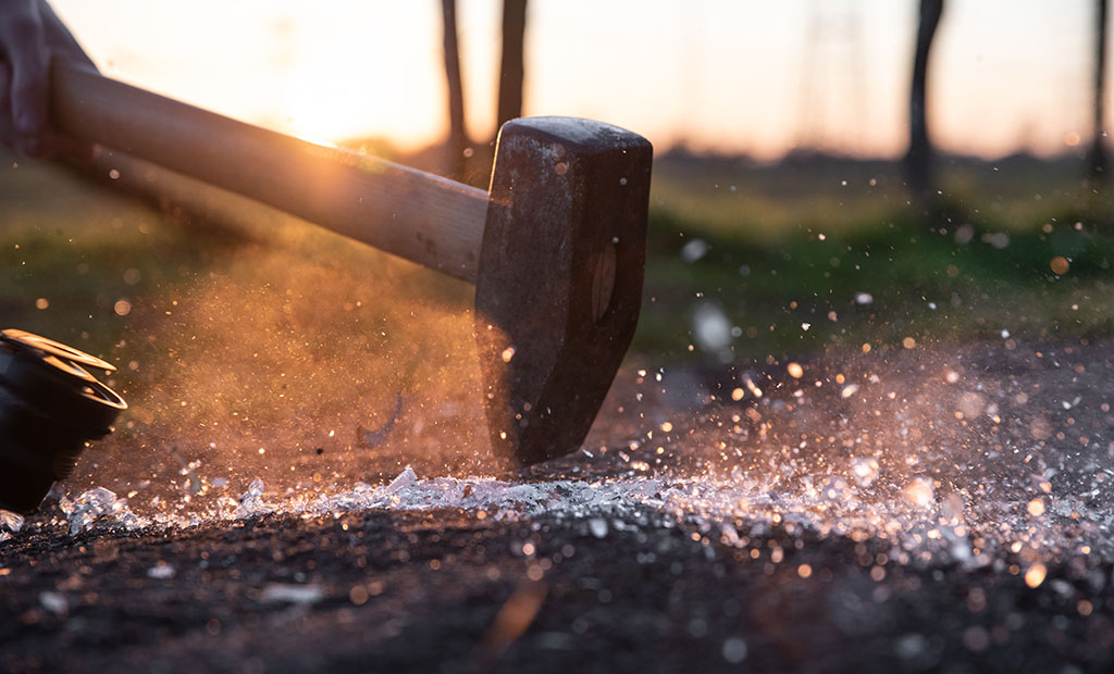 Hitting glass with a hammer