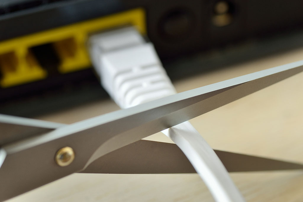 Scissors cutting computer cable