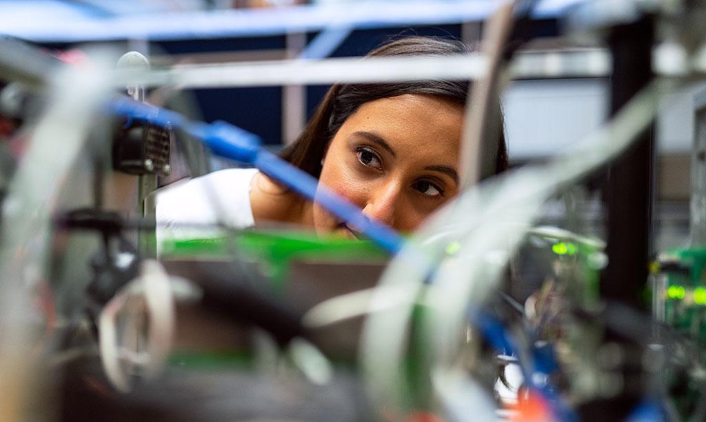 Laboratory engineer inspecting equipment